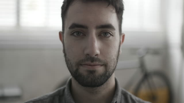 portrait of male creative office worker - rivolto verso l'obiettivo video stock e b–roll
