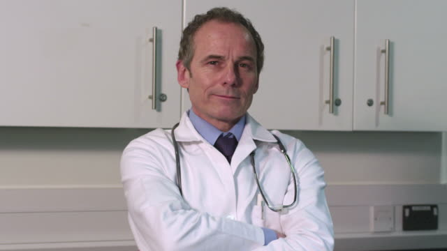 portrait of male doctor - greater london stock videos & royalty-free footage