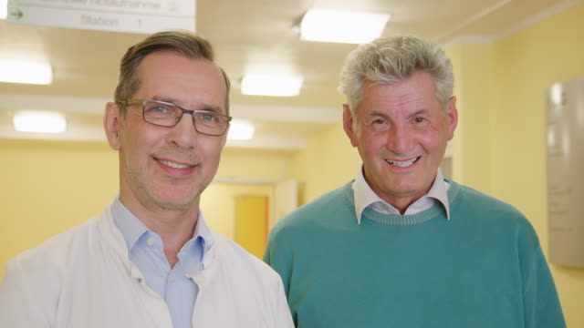 portrait of male doctor with patient in hospital - rehabilitation center stock videos & royalty-free footage