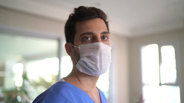 portrait of male nurse with face mask - medical scrubs stock videos & royalty-free footage