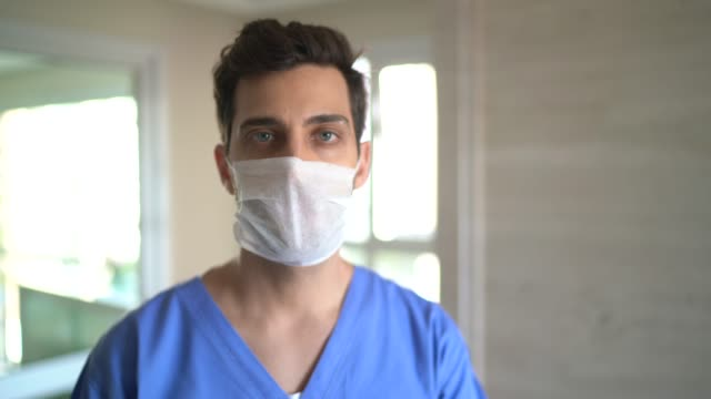 portrait of male nurse with face mask - male nurse stock videos & royalty-free footage