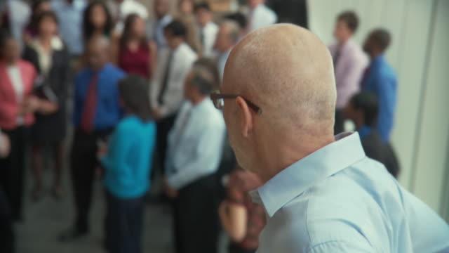 CU Portrait of male senior executive before employee gathering / South Orange, New Jersey, USA