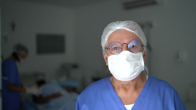 portrait of male senior nurse at surgery on hospital - filmato non girato negli usa video stock e b–roll