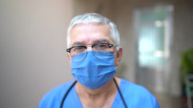 portrait of male senior nurse/doctor - males stock videos & royalty-free footage