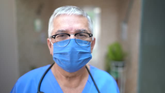 portrait of male senior nurse/doctor - protective workwear stock videos & royalty-free footage