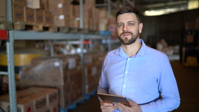 portrait of male warehouse worker using digital tablet - quality control stock videos & royalty-free footage