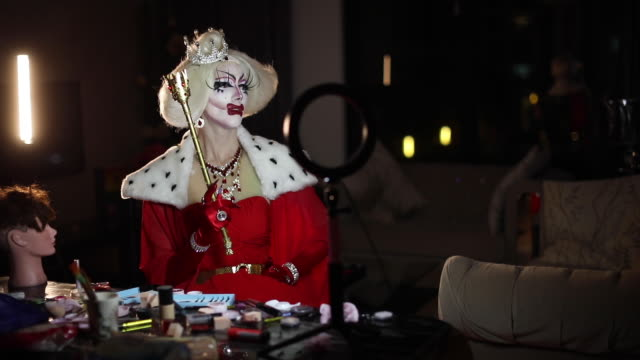 portrait of man drag queen in red dress - drag queen stock videos and b-roll footage