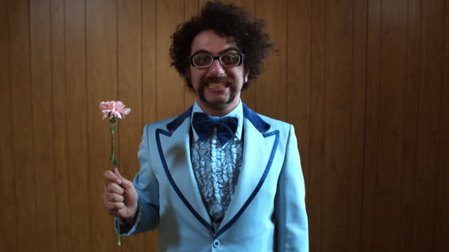 ms portrait of man in blue suit holding pink carnation and waving, atlanta, georgia, usa - carnation flower stock videos & royalty-free footage