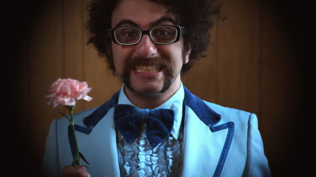 cu portrait of man in blue suit holding pink carnation and waving, atlanta, georgia, usa - carnation flower stock videos & royalty-free footage