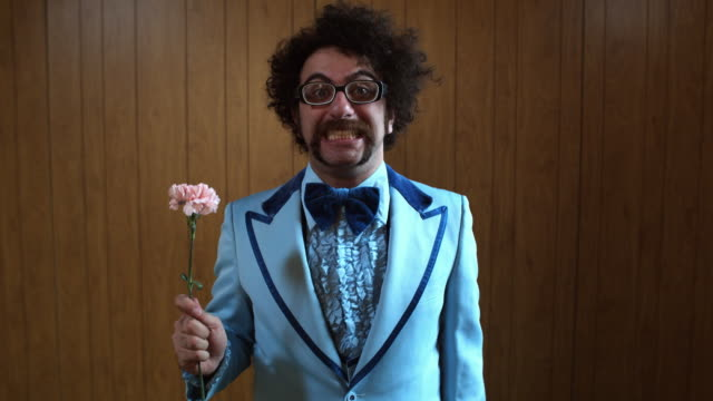 ms portrait of man in blue suit holding pink carnation, atlanta, georgia, usa - carnation flower stock videos & royalty-free footage