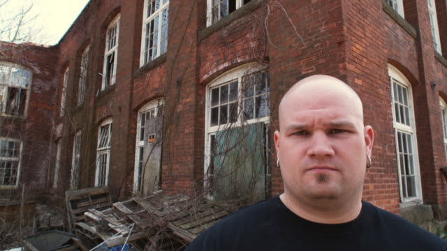 cu portrait of man in front of deserted factory building, middletown, connecticut, usa - 30 34 years stock videos & royalty-free footage