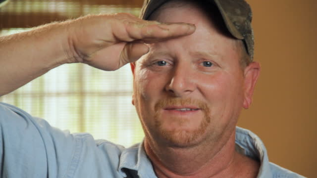 cu portrait of man in military cap saluting / madison, florida, usa - saluting stock videos & royalty-free footage