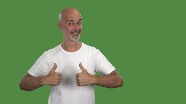 portrait of man on green screen in 4k showing many different emotions - one mature man only stock-videos und b-roll-filmmaterial