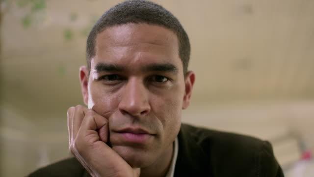 cu portrait of man sitting at office, appleton, wisconsin, usa - appleton video stock e b–roll