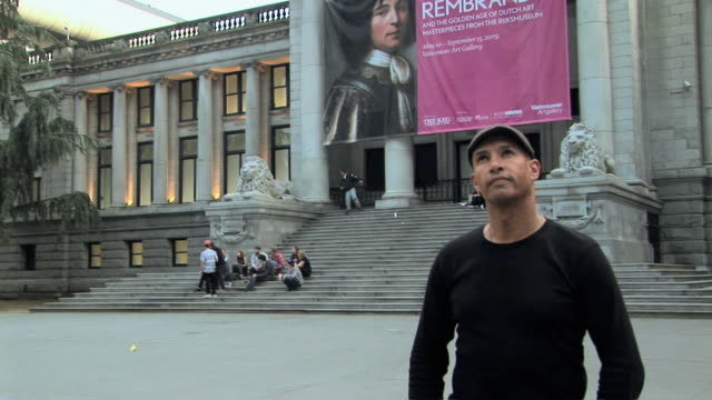ms td portrait of man standing in front of vancouver art gallery, vancouver, british columbia, canada - schiebermütze stock-videos und b-roll-filmmaterial