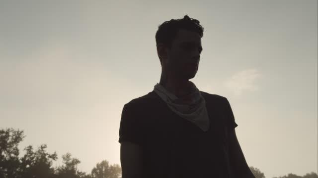 vídeos de stock, filmes e b-roll de portrait of man standing on large rock in river at sunrise - new paltz