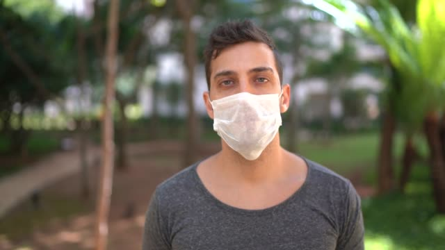 portrait of man wearing face mask - prevention stock videos & royalty-free footage