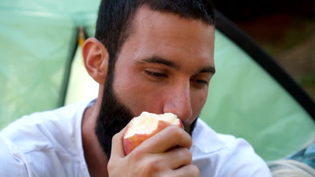 portrait of man who eat apple - super slow mo - apple fruit stock videos & royalty-free footage