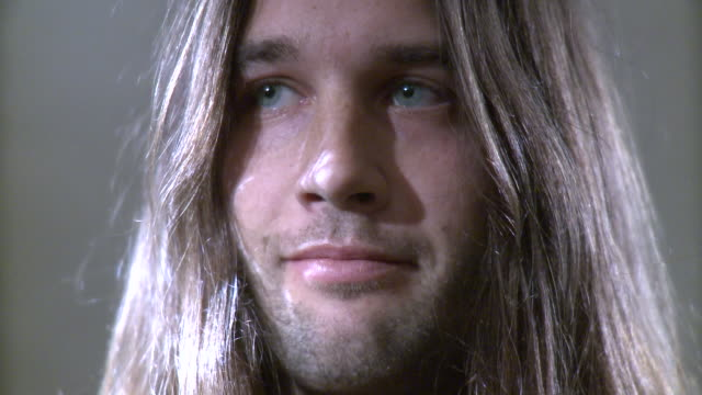cu portrait of man with long hair in studio - sideways glance stock videos & royalty-free footage