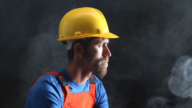 Portrait of Manual Worker Smoking In Dark