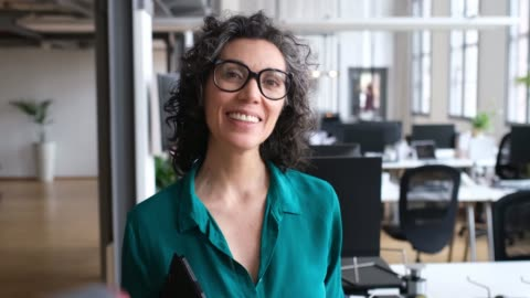 portrait of mature businesswoman with laptop - eyeglasses stock videos & royalty-free footage