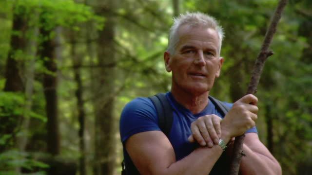 portrait of mature man holding walking stick - kelly mason videos stock videos & royalty-free footage