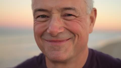 cu portrait of mature man smiling / clinton, new jersey, usa - le bildbanksvideor och videomaterial från bakom kulisserna
