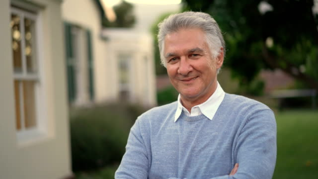 portrait of mature man smiling in yard - raised eyebrows stock videos & royalty-free footage