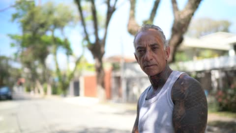 portrait of mature men stretching in street - grey hair stock videos & royalty-free footage