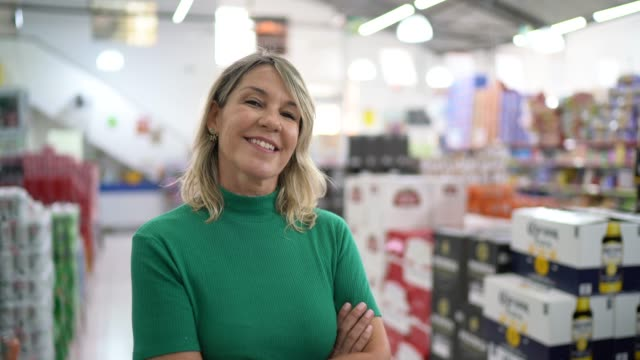 portrait of mature woman at wholesale - arms crossed stock videos & royalty-free footage