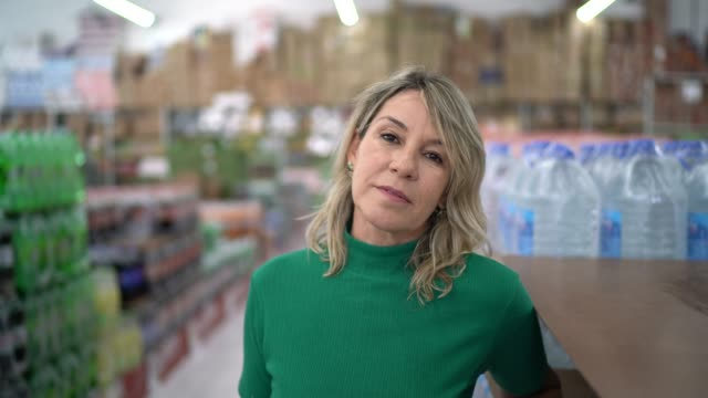portrait of mature woman at wholesale - serious stock videos & royalty-free footage