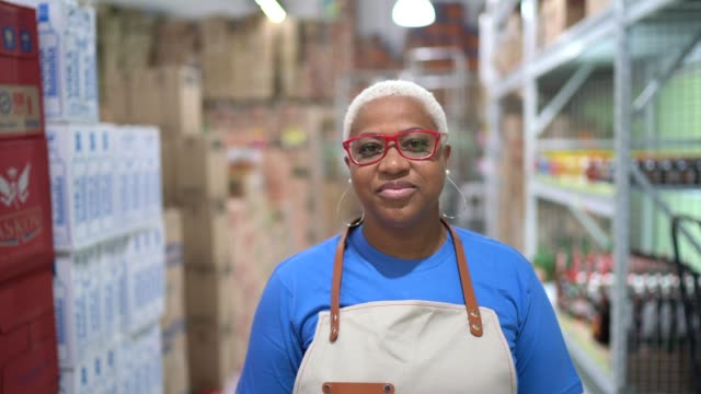 portrait of mature woman employee at wholesale - owner stock videos & royalty-free footage