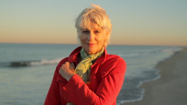 ms portrait of mature woman standing on beach / clinton, new jersey, usa - grey hair stock videos & royalty-free footage