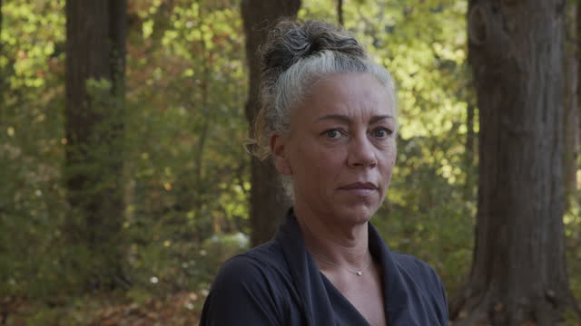 portrait of mature woman standing outdoor after workout - grey hair stock videos & royalty-free footage