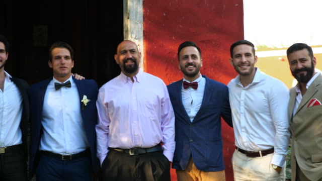 MS Portrait of men in wedding party standing if front of chapel
