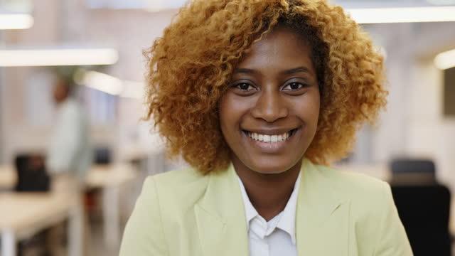 portrait of mid 20s black businesswoman in modern office - headshot stock videos & royalty-free footage