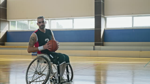 portrait of mid adult male wheelchair basketball - wheelchair basketball stock videos & royalty-free footage