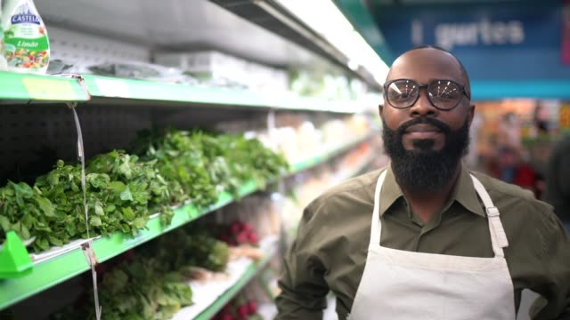 portrait of mid adult man supermarket owner / employee - greengrocer stock videos & royalty-free footage