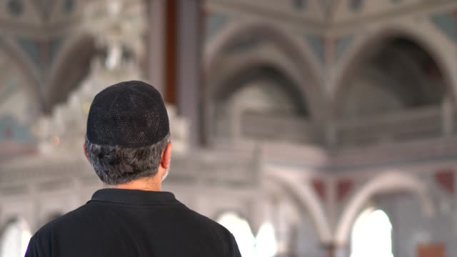 portrait of mid adult muslim man praying in mosque - sufism stock videos & royalty-free footage