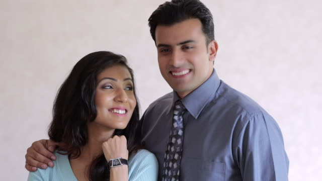 ms portrait of mid-adult couple indoors / india - mid adult couple stock videos & royalty-free footage