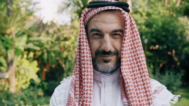 portrait of middle east man with green tree in background. - saudi arabia stock videos & royalty-free footage
