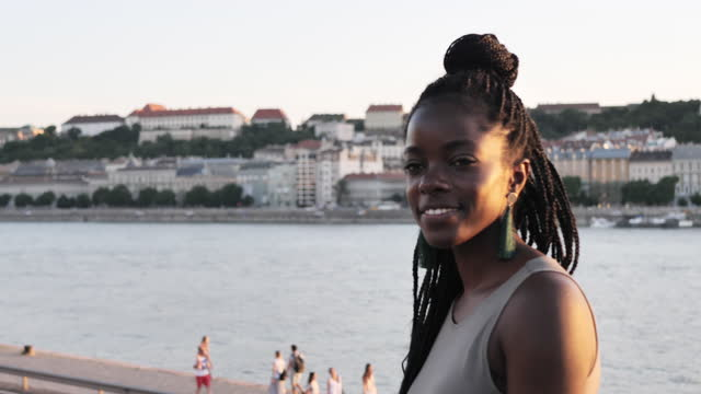 portrait of millennial african woman with braided hair - slow motion video - braided hair stock videos & royalty-free footage