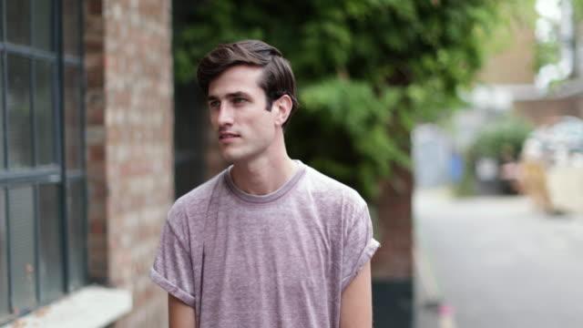 Portrait of millennial male outdoors on street
