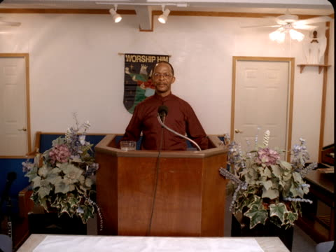 ms, portrait of minister standing at pulpit in church, reno, nevada, usa - pastor stock videos & royalty-free footage