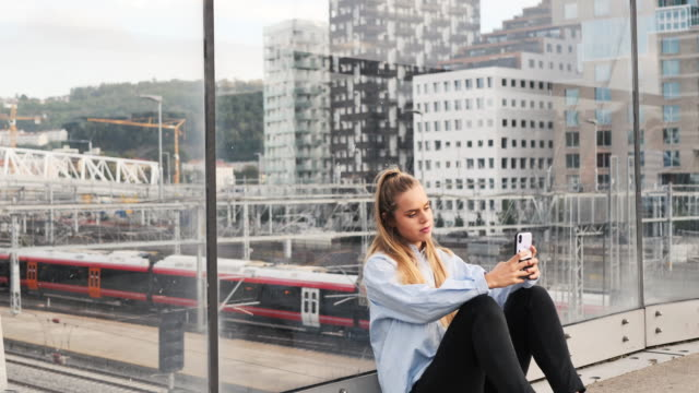 portrait of modern blonde hair woman using phone outdoors - city life stock videos & royalty-free footage