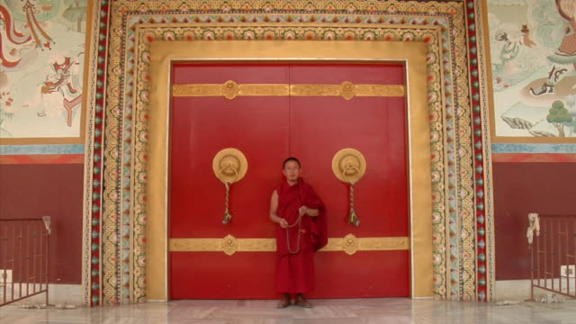 WS, Portrait of monk standing at Tibetan Monastery, Bodh Gaya, Bihar, India