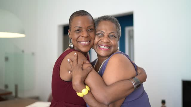 portrait of mother and daugher embracing at home - 45 49 years stock videos & royalty-free footage