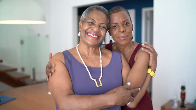 portrait of mother and daugher embracing at home - daughter stock videos & royalty-free footage