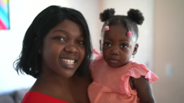 portrait of mother and daughter at home - afro stock videos & royalty-free footage