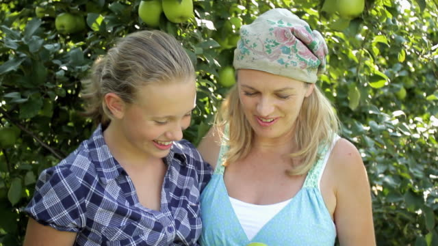 MS Portrait of mother and daughter (12-13) in apple orchard / Lebonan Township, New Jersey, USA
